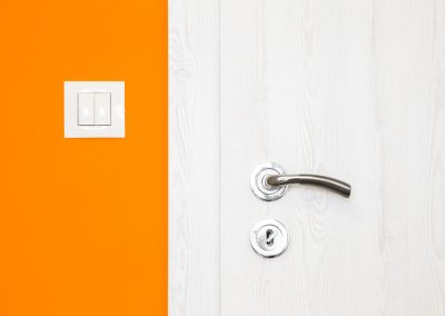 Electricity switch in a bright orange wall